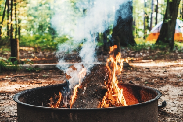 Starting a campfire at campsite