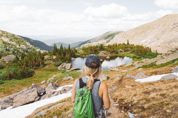Woman hiking on a Colorado trail - HelloTrail